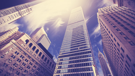 lower manhattan: Vintage toned picture of skyscrapers in Lower Manhattan, looking up at sky, New York City, USA. Stock Photo