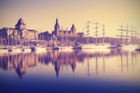 intrepid: Vintage retro toned photo of sailing ships to the Brave Embankment at sunrise in Szczecin Poland.