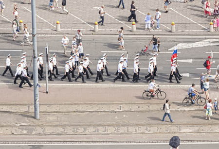 adult cruise: Szczecin, Poland - June 13, 2015: Sedov sailing ship crew parade on Chrobry Embankment during the Tall Ships Regatta 2015 Final. The ship is the largest training tall ship in the world. Editorial