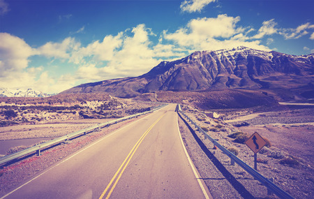 el chalten: Vintage toned picture of a road, Argentina. Stock Photo