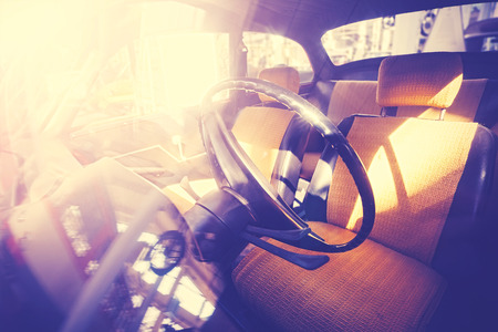 against the sun: Vintage filtered old car interior against sun.