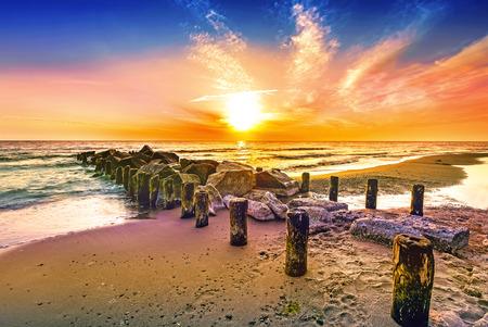 orange sunset: Colourful sunset on a beach. Stock Photo