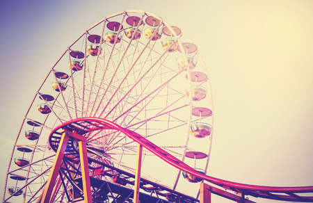 Retro vintage instagram stylized picture of an amusement park. 写真素材