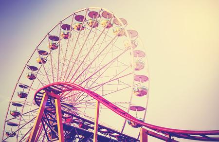Retro vintage instagram stylized picture of an amusement park. Standard-Bild