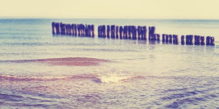 tilt view: Vintage toned panoramic beach view with tilt shift effect, summer nature background.