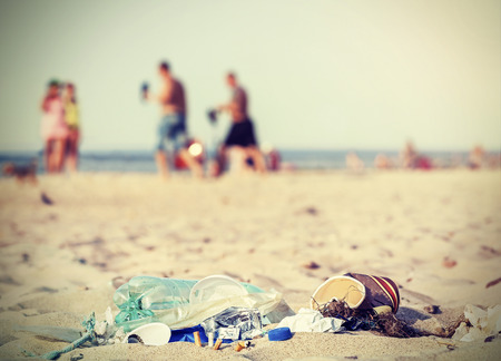 Retro filtered garbage on a beach left by tourist, environmental pollution concept picture, Baltic Sea, Poland. Standard-Bild
