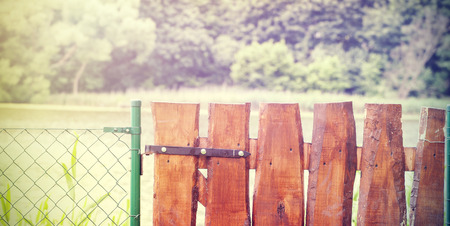 garden gate: Retro wooden garden gate and wire fence.