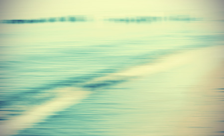 wave abstract: Motion blurred sea background, retro cross processed colors. Stock Photo