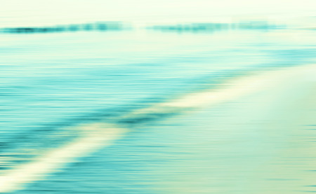 cross processed: Motion blurred sea background, retro cross processed colors. Stock Photo