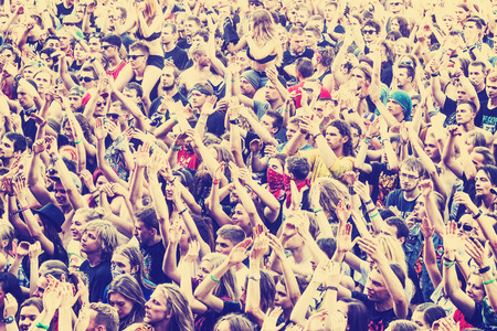 Kostrzyn nad Odra, Poland - August 1, 2015: People applauding concert on the 21th Woodstock Festival Poland, one of the biggest open air festivals in Europe, retro toned. Editorial