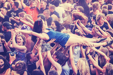 Kostrzyn nad Odra, Poland - August 1, 2015: People having fun during concert on the 21th Woodstock Festival Poland, one of the biggest view open air festivals in Europe, vintage toned.