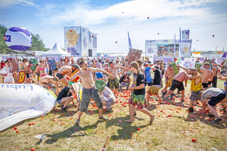 Kostrzyn nad Odra, Poland - August 1, 2015: Tomato fight on the 21th Woodstock Festival Poland (Przystanek Woodstock), one of the biggest ticket free rock music festivals in Europe.