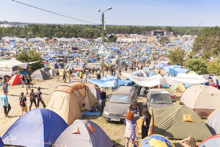 woodstock: Kostrzyn nad Odra, Poland - August 1, 2015: Tent village and resting area on the 21th Woodstock Festival Poland, one of the biggest open air festivals in Europe. Editorial