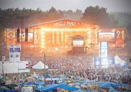 rock stage: Kostrzyn nad Odra, Poland - August 1, 2015: Evening view of concert on main stage and tents at the 21th Woodstock Festival Poland (Przystanek Woodstock).