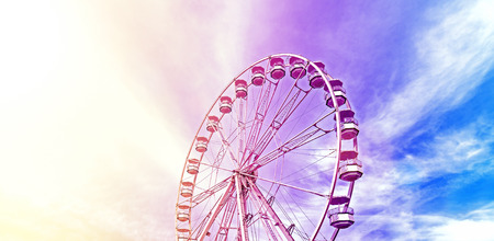 Vintage stylized picture of a ferris wheel, space for text. Imagens