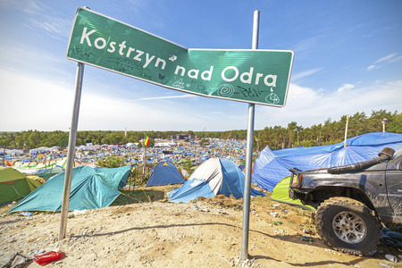 woodstock: Kostrzyn nad Odra, Poland - August 1, 2015: City name board on the 21th Woodstock Festival Poland, one of the biggest open air festivals in Europe.