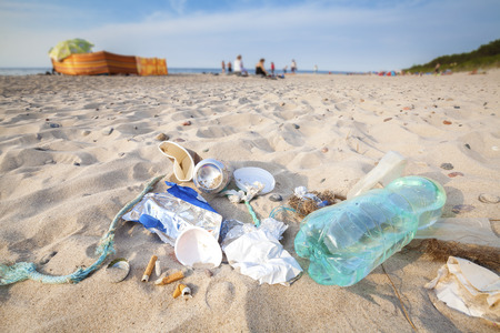 Garbage on a beach left by tourist, environmental pollution concept picture, Baltic Sea coast, Poland.