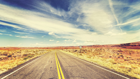 desert sun: Retro vintage old film style endless country highway in USA, travel adventure concept. Stock Photo