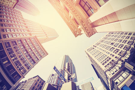 NYC: Vintage filtered fisheye picture of Manhattan, looking up at sky, New York City, USA. Stock Photo