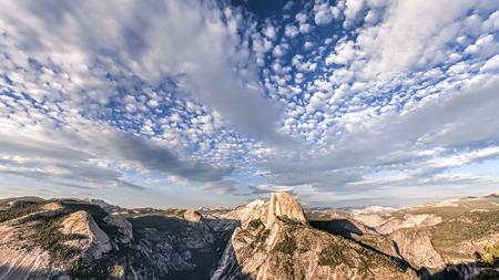 half dome: Beautiful sky over Half Dome mountain, Yosemite National Park at sunset, California, USA. Stock Photo