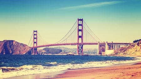 california beach: Retro style photo of Golden Gate Bridge, San Francisco, California, USA.