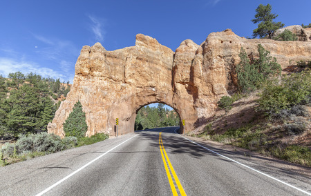 byway: Natural arch road tunnel on the Scenic Byway 12, Utah, USA. Stock Photo