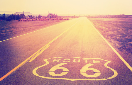 routes: Vintage filtered sunset over Route 66, California, USA.