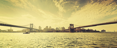 new york skyline: Old film retro style New York waterfront view with famous Brooklyn and Manhattan Bridges, USA. Stock Photo
