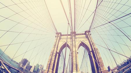 Retro stylized photo of Brooklyn Bridge, fisheye lens, NYC, USA.
