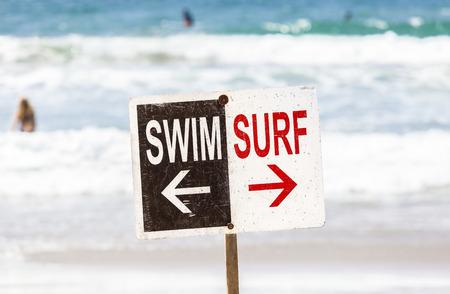 malibu: Swim and surf sign on the beach, shallow depth of field, summer holidays concept, Venice Beach in California, USA.