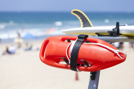 beach buoy: Lifeguard red buoy on a beach, shallow depth of field, space for text, California, USA. Stock Photo