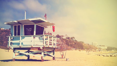 california: Retro stylized panoramic picture of a lifeguard tower in Santa Monica at sunset, California, USA.