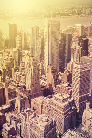 sunset city: Vintage style picture of Manhattan at sunset, New York, USA.