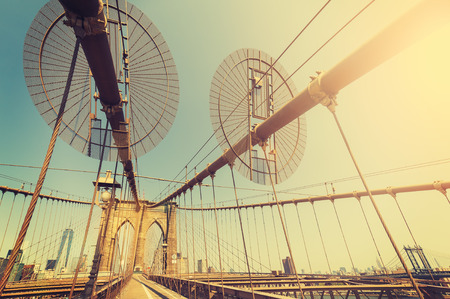 new filter: Vintage toned fisheye lens picture of Brooklyn Bridge in New York City, USA.