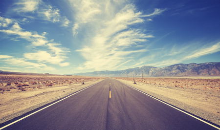 deserts: Vintage style country highway in USA, travel adventure concept. Stock Photo