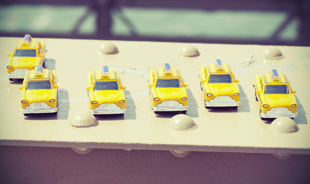cross processed: Cross processed photo of taxi toys on Brooklyn Bridge, travel concept.