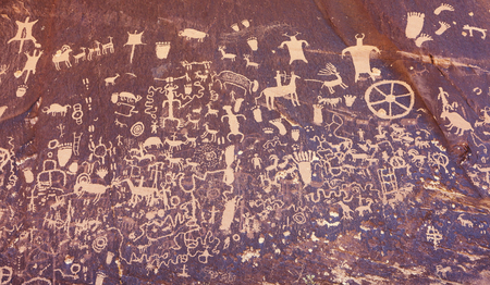Ancient symbols texture, Petroglyphs on Newspaper Rock, Utah, USA.