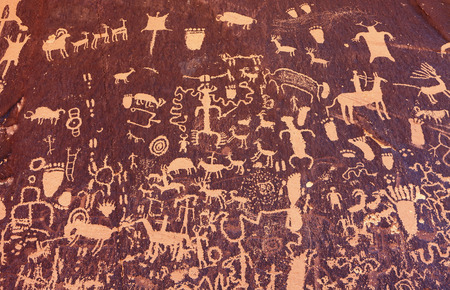 Ancient symbols texture, Petroglyphs on Newspaper Rock, Utah, USA.