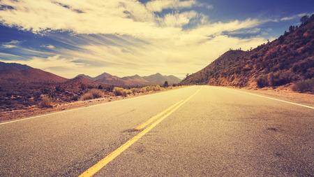 desert road: Vintage retro stylized desert road, USA.