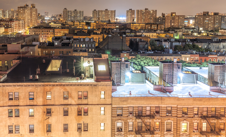 Harlem neighborhood at night, New York City, USA.
