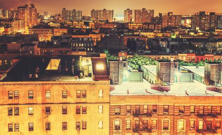 impoverished: Retro toned Harlem neighborhood at night, NYC, USA.