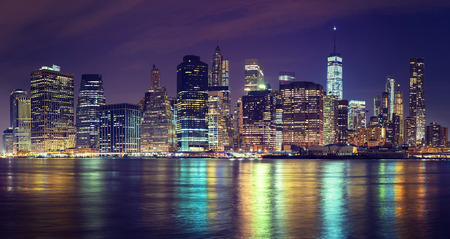 usa cityscape: Vintage toned Manhattan skyline at night, NYC, USA.
