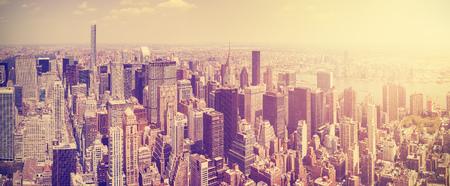 Vintage toned Manhattan skyline at sunset, New York City, USA.
