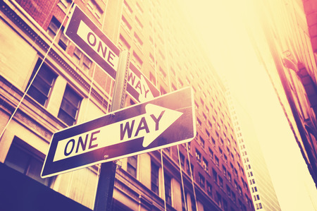 signpost: Vintage style photo of the one way signs in Manhattan, New York, USA.