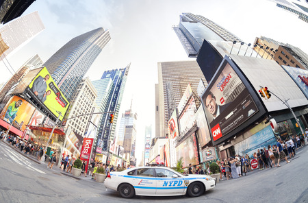 patrol car: New York, USA - August 17, 2015: Fisheye lens photo of a NYPD patrol car parked at the Times Square crowded with tourists and pedestrians.