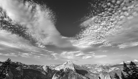 half dome: Black and white photo of cloudscape over Half Dome in Yosemite National Park, USA. Stock Photo