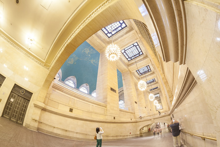 efficiently: New York, USA - August 15, 2015: Fisheye lens photo of Grand Central Terminal interior, first station to largely eliminate staircases by use of ramps to more efficiently accommodate pedestrian flows. Editorial