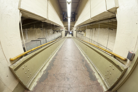 efficiently: New York, USA - August 15, 2015: Fisheye lens photo of a ramp in Grand Central Terminal, first station to largely eliminate staircases by use of ramps to more efficiently accommodate pedestrian flows.