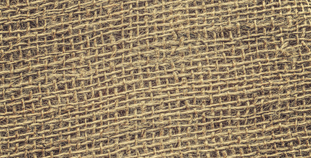 Retro toned high quality close up picture of jute fabric.