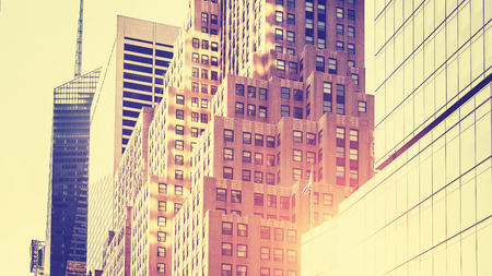 high key: Vintage toned high key picture of skyscrapers against sun, New York, USA.